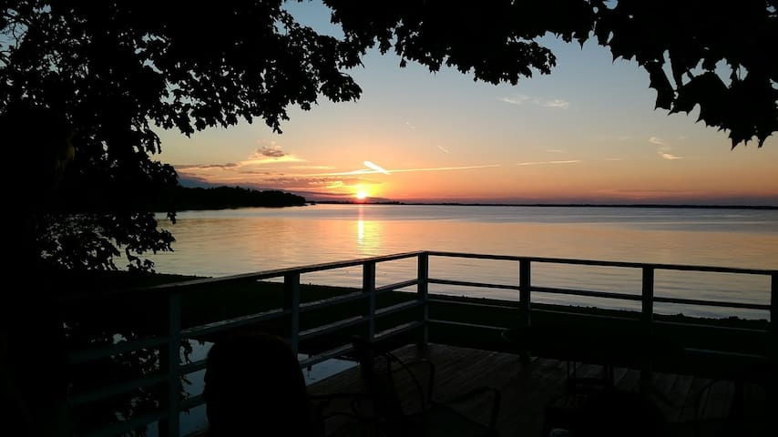 Guests have access to the boat house patio and waterfront for great sunset views.