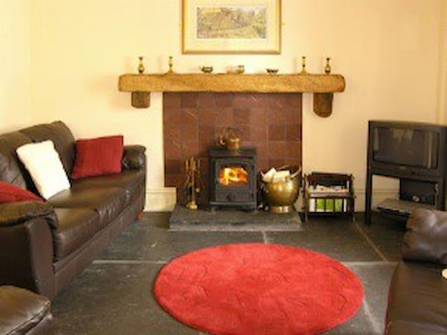 Snug living room with wood burning stove.
