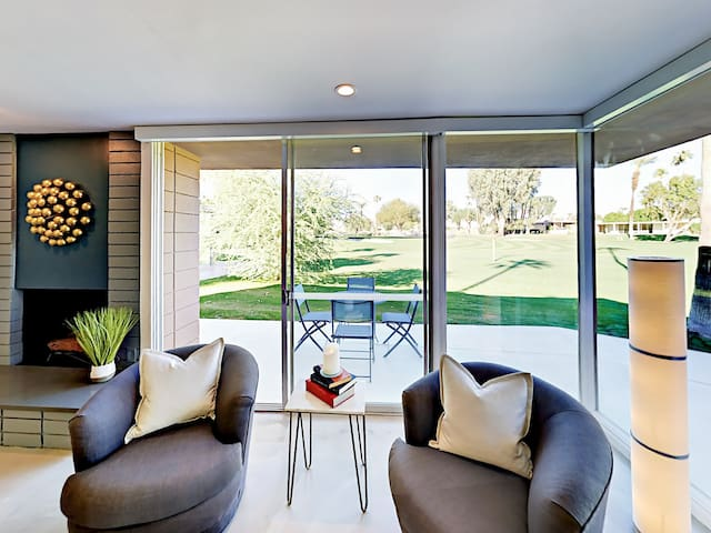Wall-to-wall windows offer beautiful views of the lush fairway.