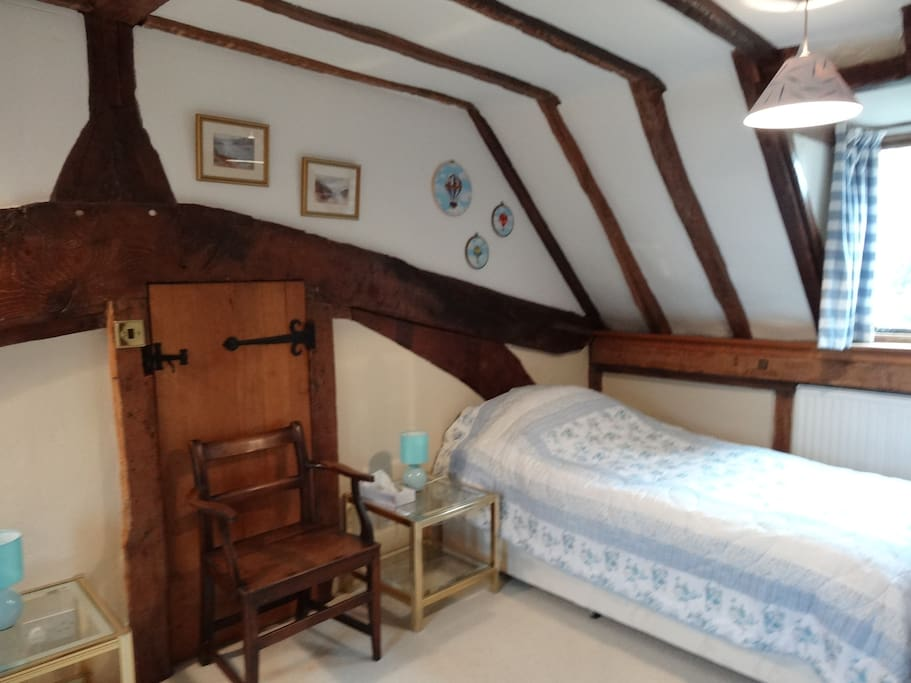 This bedroom is located in the 1st bay of a 2-bay Wealden Hall house