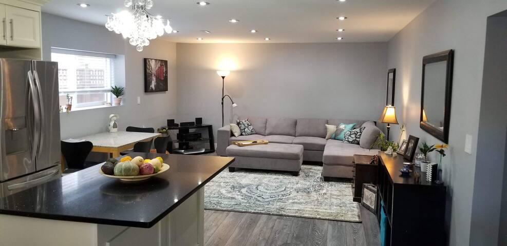 Bright and spacious garden suite near skytrain