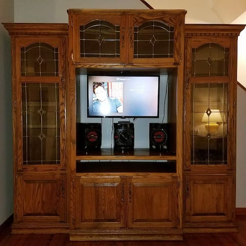 """Livingroom Entertainment Center with stereo and 32"""" TV with Mini Roku Player with Netflix and free apps.  All other subscription channels require guest individual logins."""
