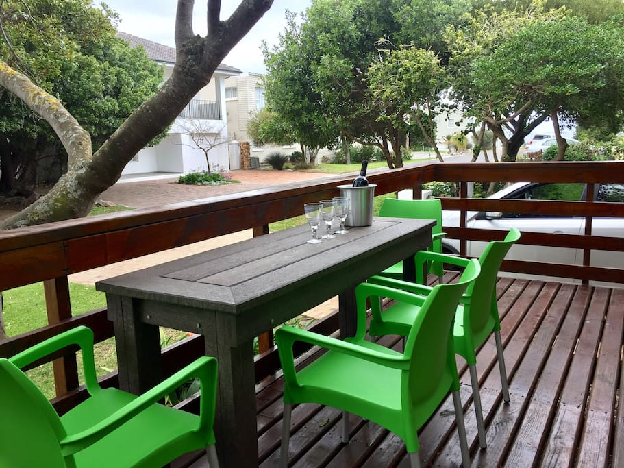 Wooden deck to sit and relax while watching holiday makers pass by and children playing in our quiet street.