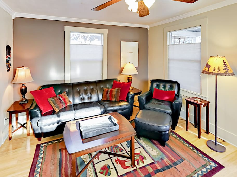 The welcoming living room includes seating for 4.