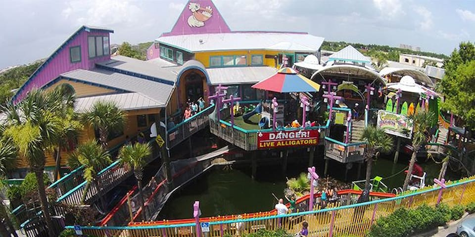 Fudpuckers Restaurant.  Only 2.1 miles from Mojo.  Fun, family restaurant where the kids can  get pics holding baby alligators and feeding their older (and larger) relatives.