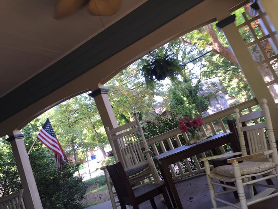 Spacious and shady front porch with plenty of seating.