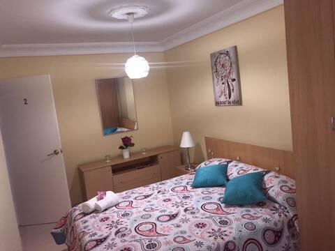 Habitación doble privada, baño externo compartido