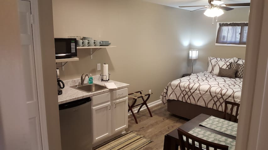 Guest bedroom #2 includes a kitchenette with seating for two.