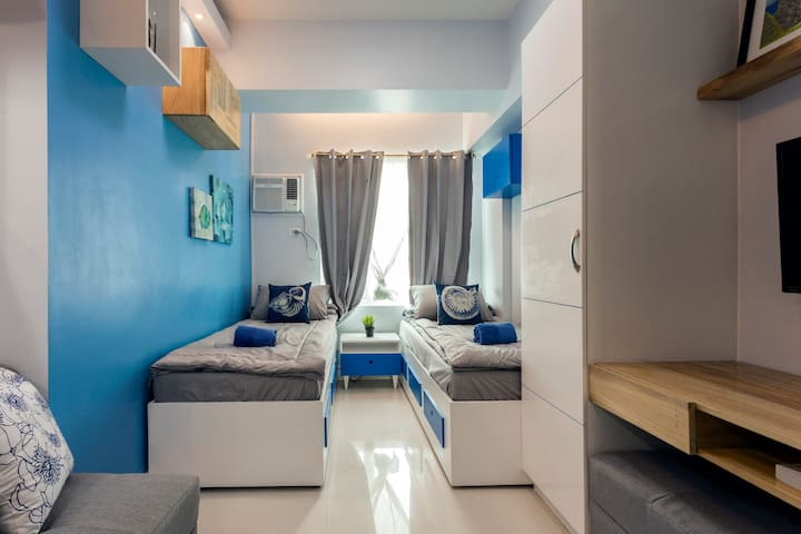 Bright and airy studio overlooking Manila skyline and a partial view of Manila Bay