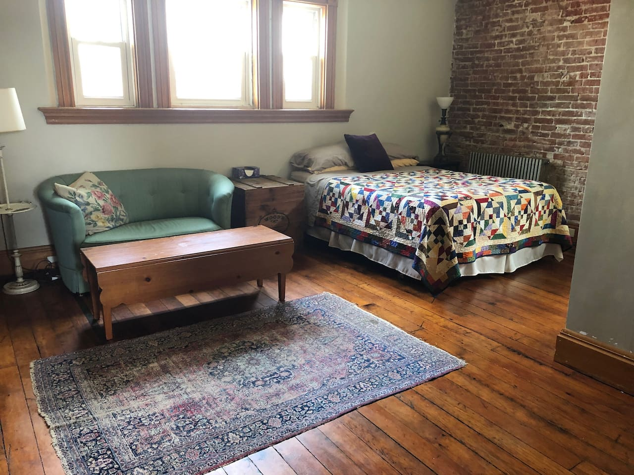 Airy, bright space that feels far, far away from it all. Full of original woodwork. Relax in the queen bed, lounge on the couch (don't mind the springs, it's old!), and plan your day exploring our vibrant neighborhood.