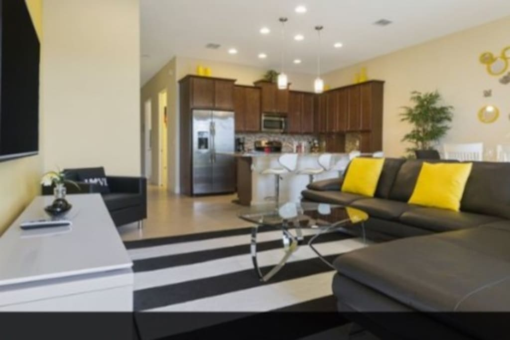 """Spacious family room with 65"""" TV and DVR player"""