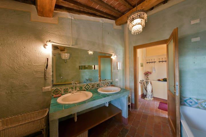 Bathroom, with bath, two sinks and lovely veranda