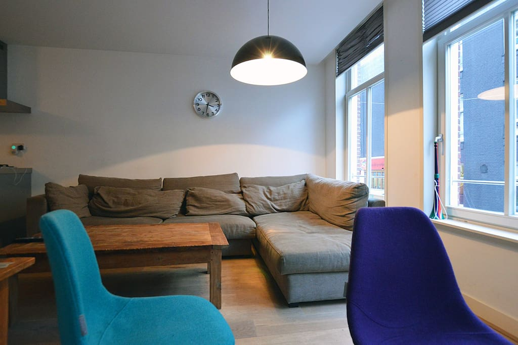 The couch is very comfortable. Have a seat after a great day of exploring Amsterdam!