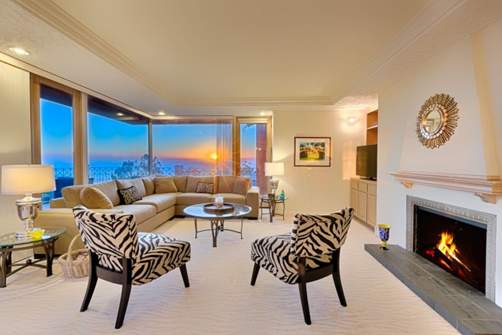 Spacious living room with ocean facing windows and cozy fireplace