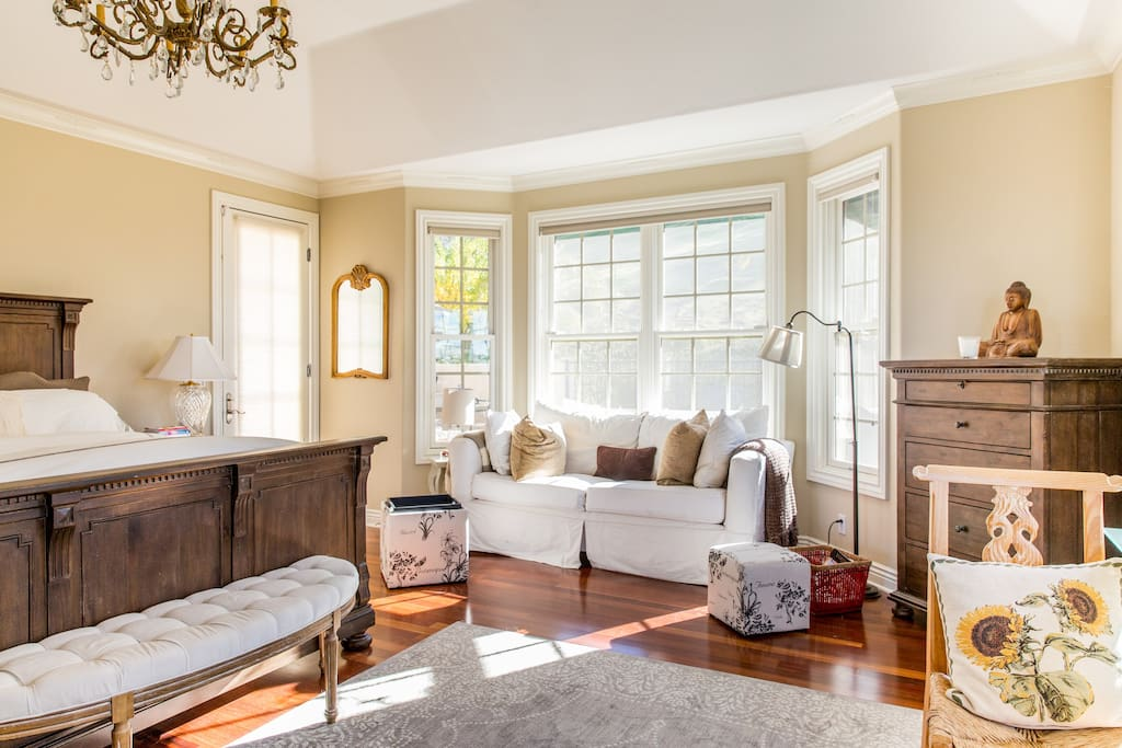 Master suite is expansive with seating area for relaxing in total privacy