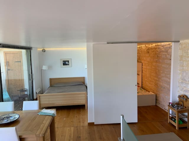 Separate small bedroom (right) with a single bed and a bunk bed. Double bed in open plan (right).