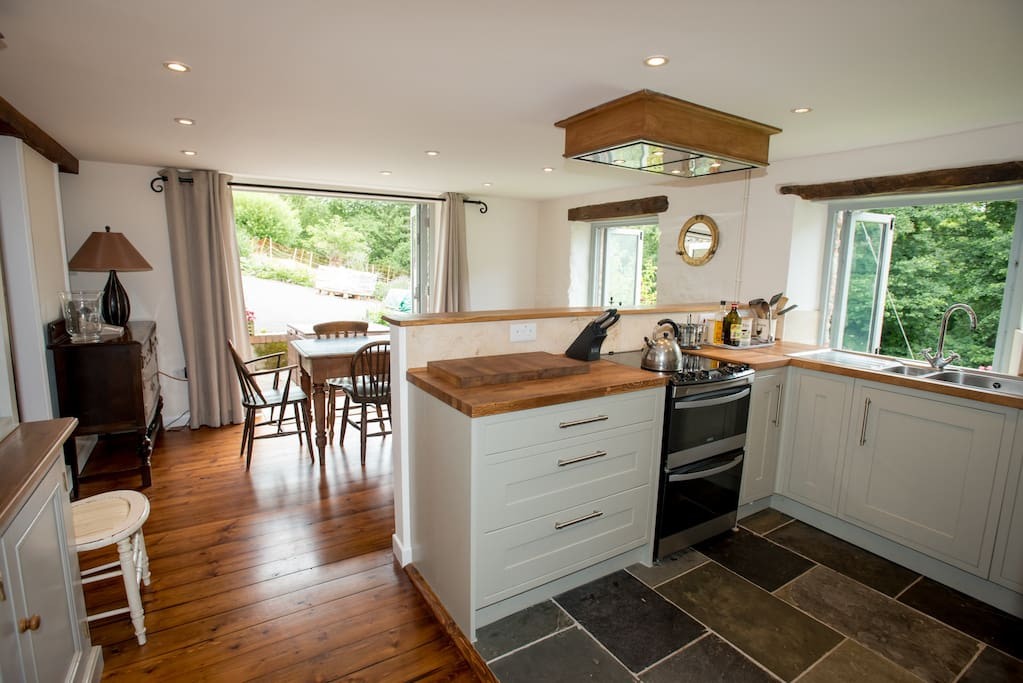 Well Equipped Kitchen with Cooker Microwave, Dishwasher and Welsh Dresser over looking the Garden