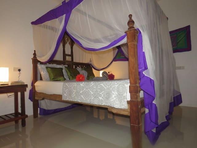 Amani king-size bedroom