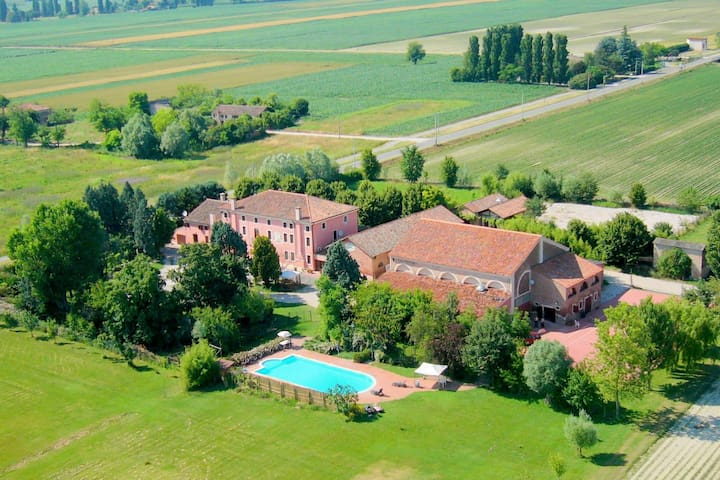 Large property on farmland with swimming pool.
