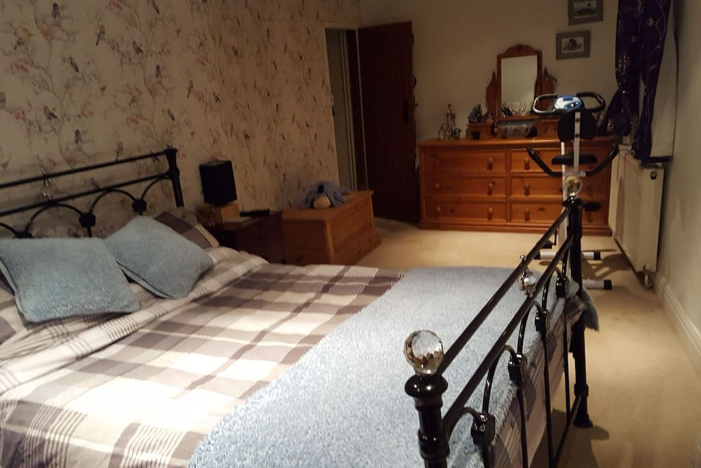 large double bedroom with tv .