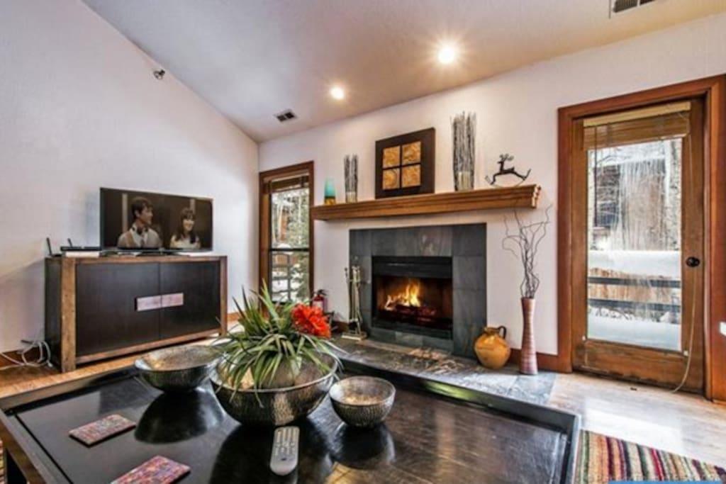 Living Room - fireplace, plenty of comfortable seating, large flatscreen HD TV, entrance to balcony