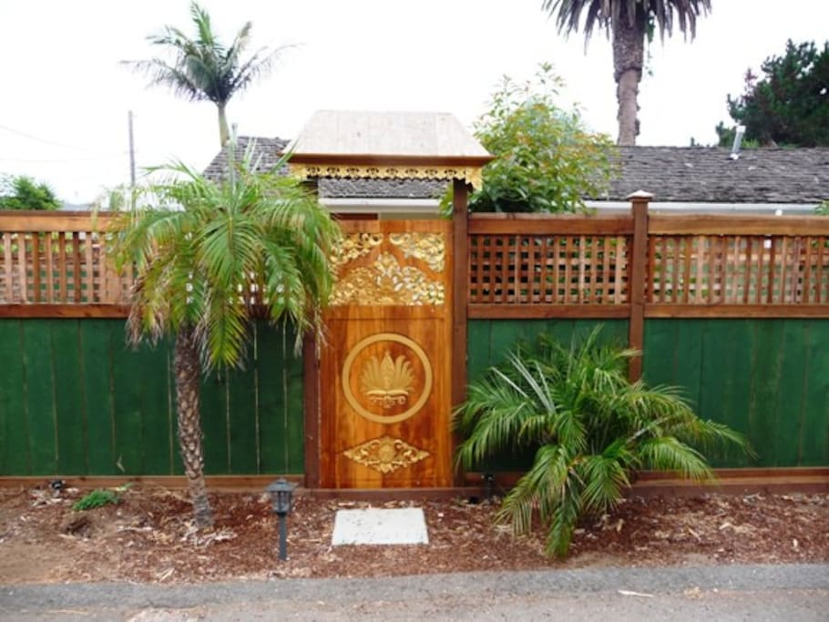 "Front entrance through a beautiful hand carved ""Golden Lotus"" teak gate from Bali. Ample free parking right in front of your private entrance."