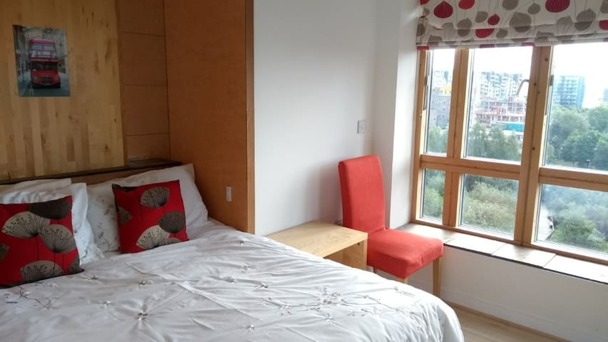 Double room in airy flat near O2, with terrace