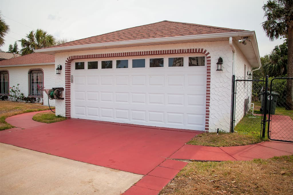 Two car garage and parking in the driveway.