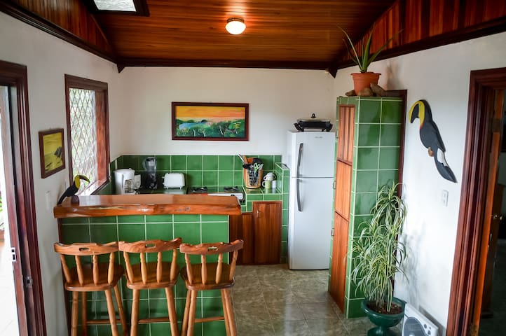 Fully equipped kitchen with teak breakfast bar.