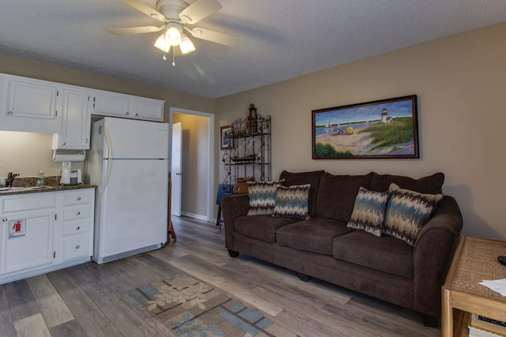 Comfortable condo w/ water views & shared pool - walk to the beach!