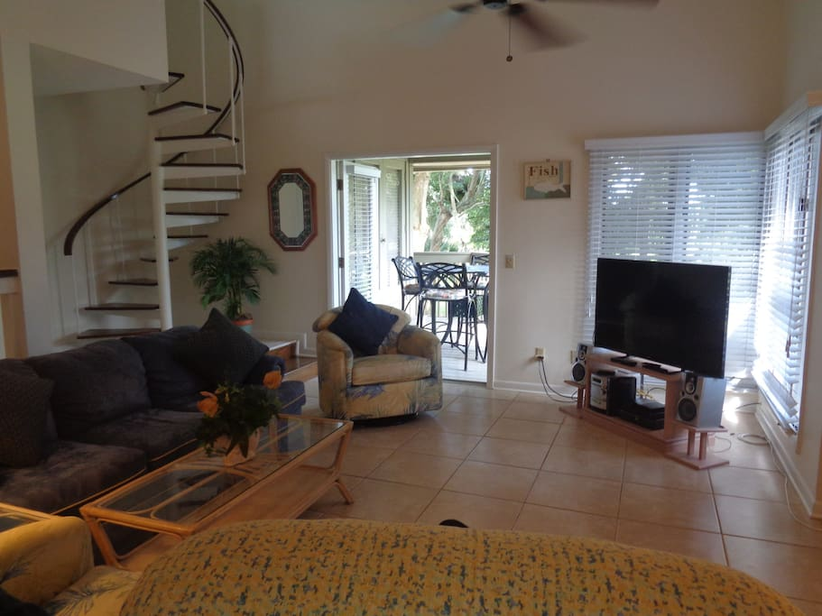 """50"""" HDTV, French doors to deck, spiral staircase to 2nd bedroom, wall to wall windows, tiled floors throughout."""