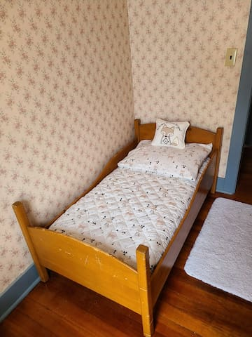 A vintage toddler bed awaits your little one!