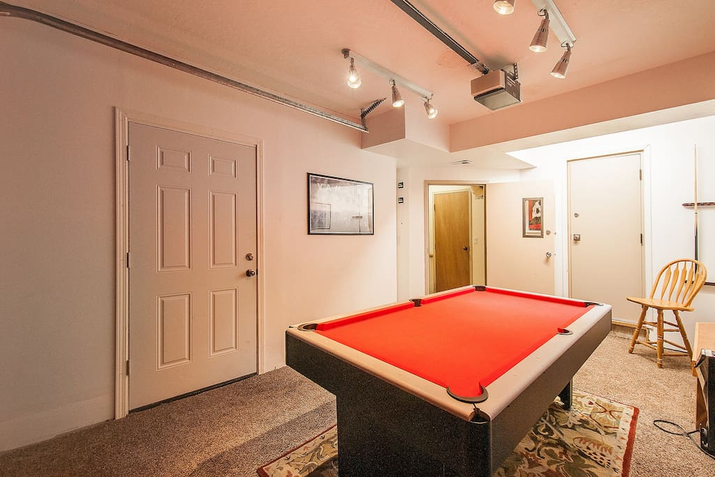 The gameroom complete with pool/ping-pong table