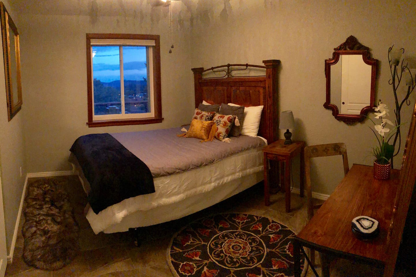Bedroom with Queen size bed and desk.