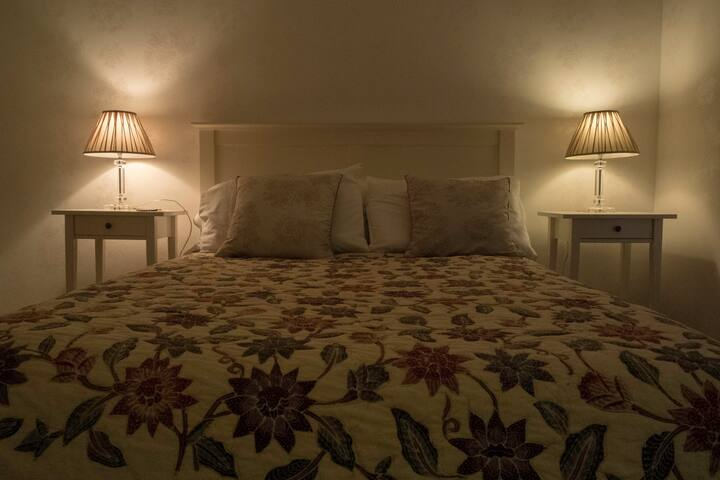 A comfortable double bed with high quality linens awaits you.