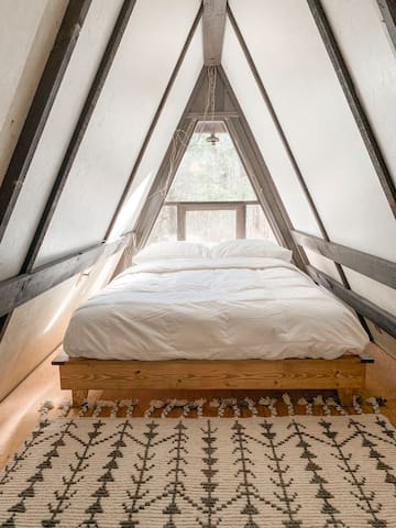 Loft bedroom in the A-frame, full size bed.