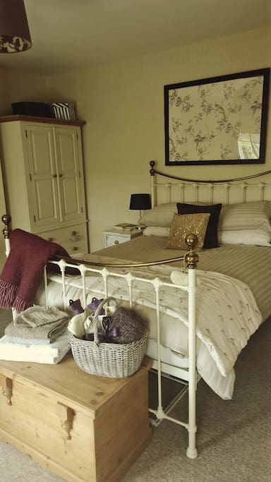 Our cosy guest room overlooks the garden and Somerset countryside