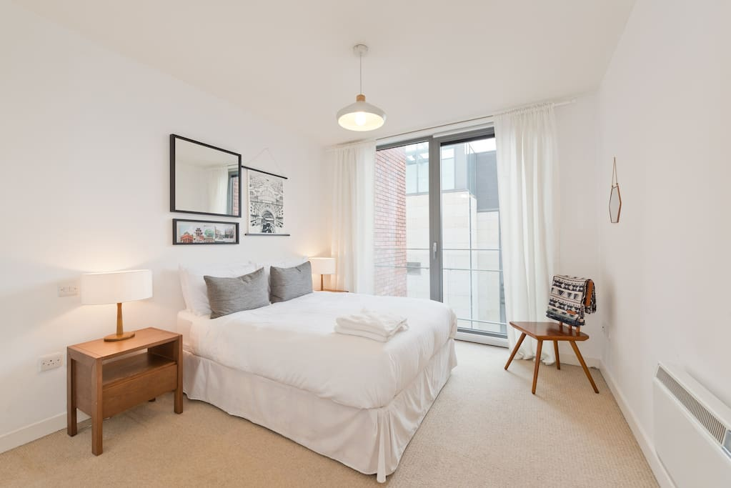 Bedroom with designer furniture and hotel grade mattress and freshly laundered sheets