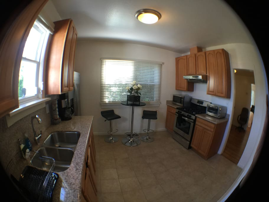 Sunny kitchen with all amenities. Feel free to use what you need to cook and feel at home.
