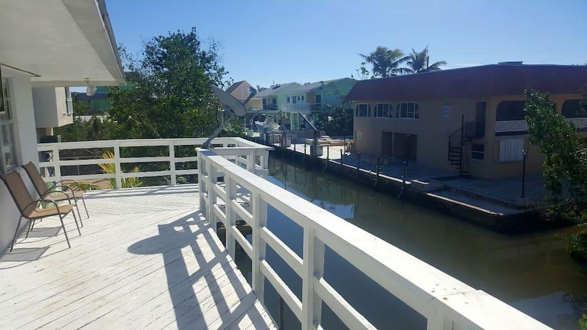 Second floor rap around deck overlooking canal.