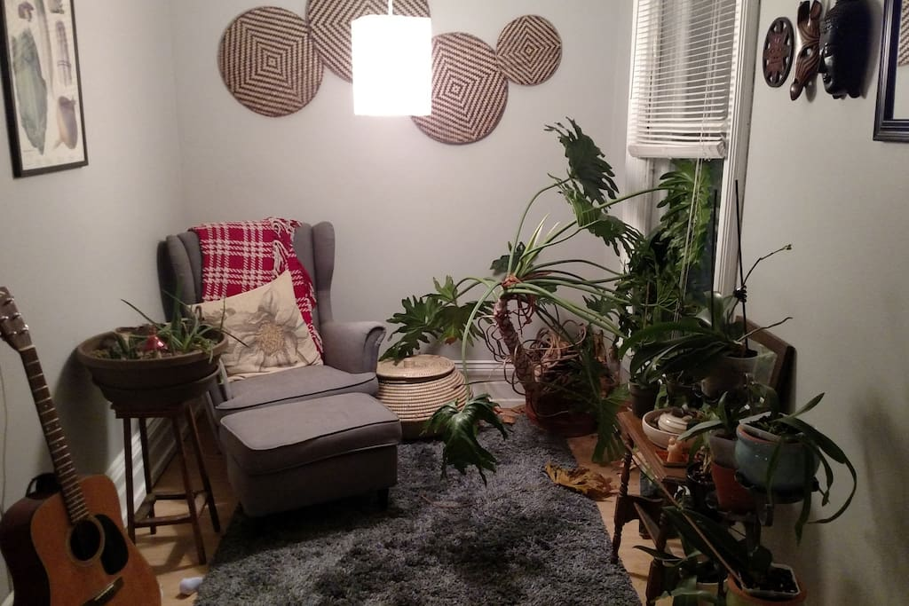 This is our reading nook. This would be your personal hang out space if you stayed with us. We also keep all our orchids here - we have 16 orchids in total. Most of the time, they will be your only company in this apartment as we both work a lot.