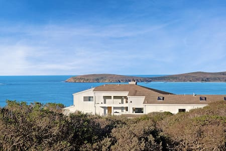 Modern home w/ stunning bay view & hot tub - steps to beach!