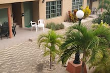 Porch & pool area inside beautiful gated Palma Real complex