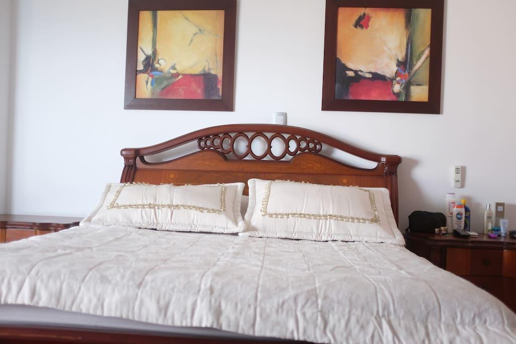 Main Room - Habitación Principal / double bed with a private bathroom, a couzy sofa and a simple bed where you have an amazing view of the beautiful beach. // Cama doble con baño privado, un sofa muy comodo extendible y una cama sencilla con una impresionante viste al mar.