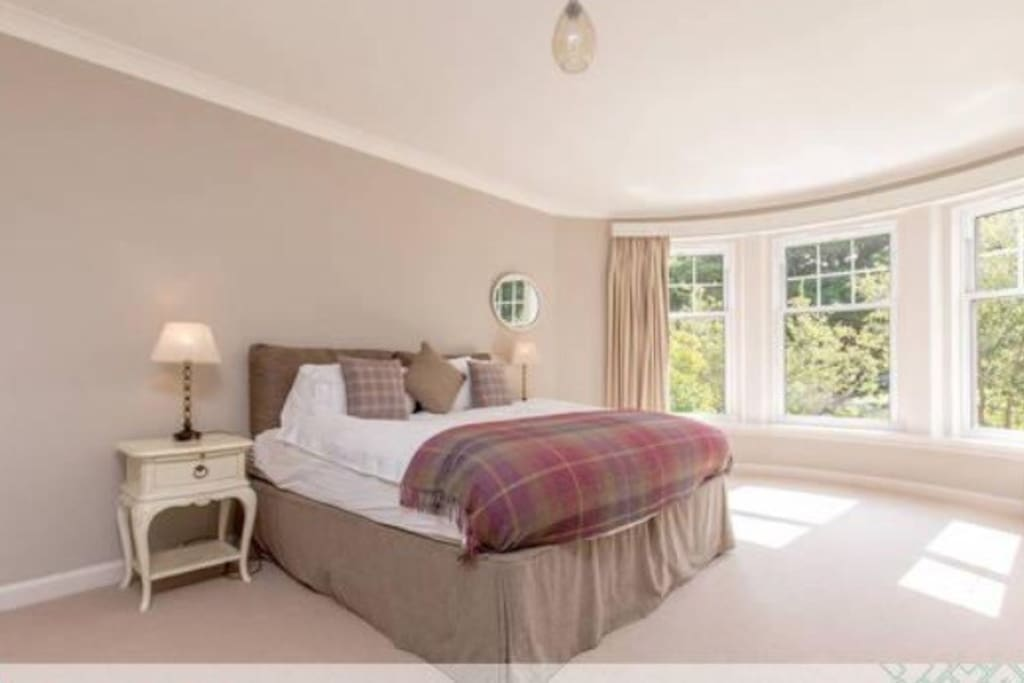 Master bedroom with super- king bed & overlooking the golf course