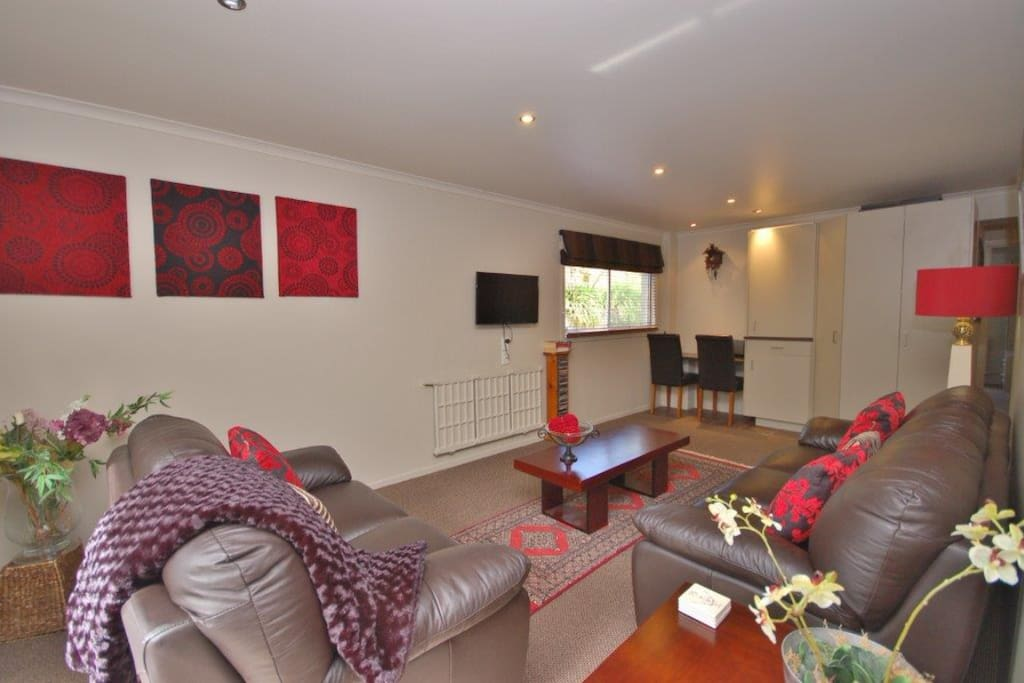 Relax in comfort in the well appointed lounge, small desk/table beside the pantry & fridge