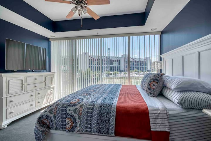 Lux King bed with a view of Bristol Motor Speedway.
