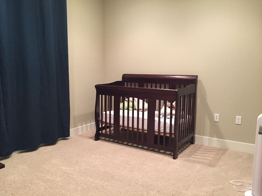 Downstairs bedroom w/ accessibility to a crib or full-size Costco air bed.