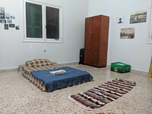 Large minimalist bedroom on Hamra street