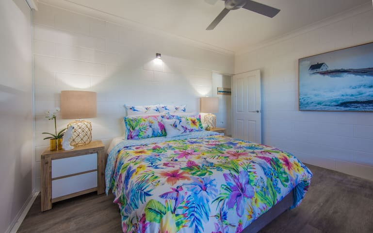 Tropical Master bedroom with bed bug mattress protector and hotel quality linen